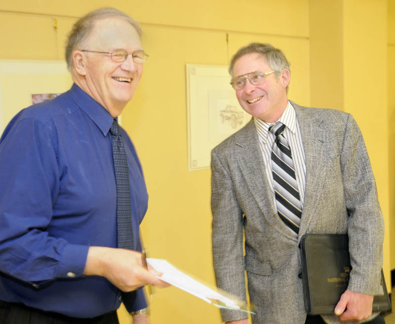 Walter E. Whitcomb, the commissioner of the Department of Agriculture, Food and Rural Resources, right, chats with Sen. Roger Sherman, R-Houlton, in the Cross State Office Building recently. Sherman is Senate chair of the Legislature's Agriculture Committee.