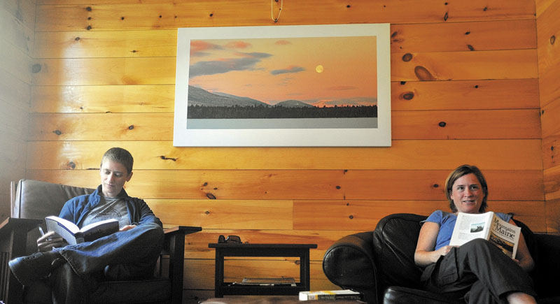 R&R: Jane Morris, left, and Meg MacDougal take advantage of the time before the dinner bell to catch up on some reading in one of the community rooms at the Flagstaff Lake Hut in Carrabassett Valley last week.