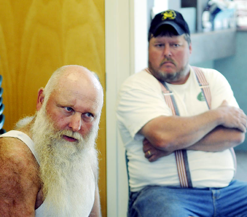 Jim Worthing, left, listens to a Randolph selectman explain a $15 fee for smelt shacks that the town has implemented during a selectmen's meeting Tuesday at Randolph Town Hall. Worthing operates a commercial smelt camp on the Kennebec River in Randolph. At right is Joey Doody.