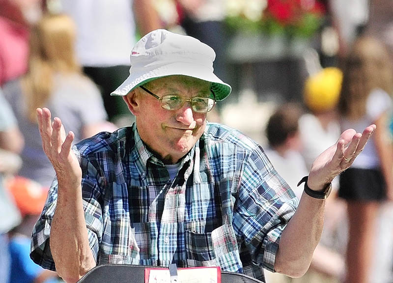 Old Hallowell Day Citizen of the Year Dick Bachelder gestures at someone in the crowd while riding in the parade down Water Street on Saturday morning.