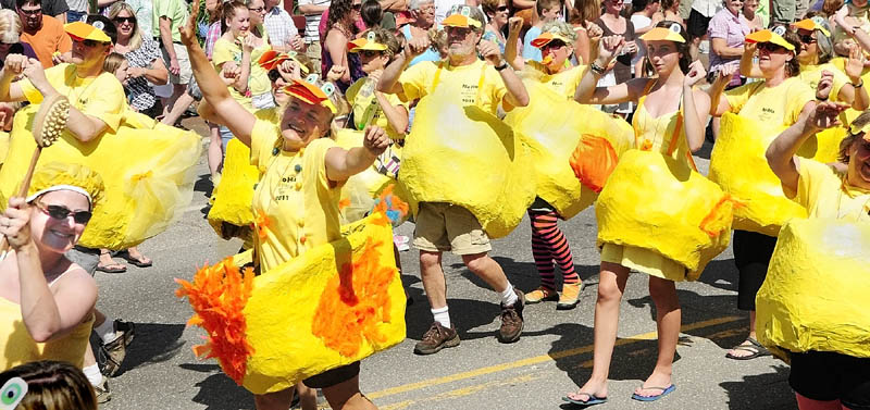 A group of dancing rubber duckies from the NoHa neighborhood group performs in front of the judges' stand during the Old Hallowell Day parade on Saturday morning. The NoHa group of dancing duckies, and a couple of bathers in towels along with Bert and Ernie, won the Grand Marshall award as best overall entry. The NoHa group is made up of residents from Pleasant and Page Streets and the name is short for North Hallowell.