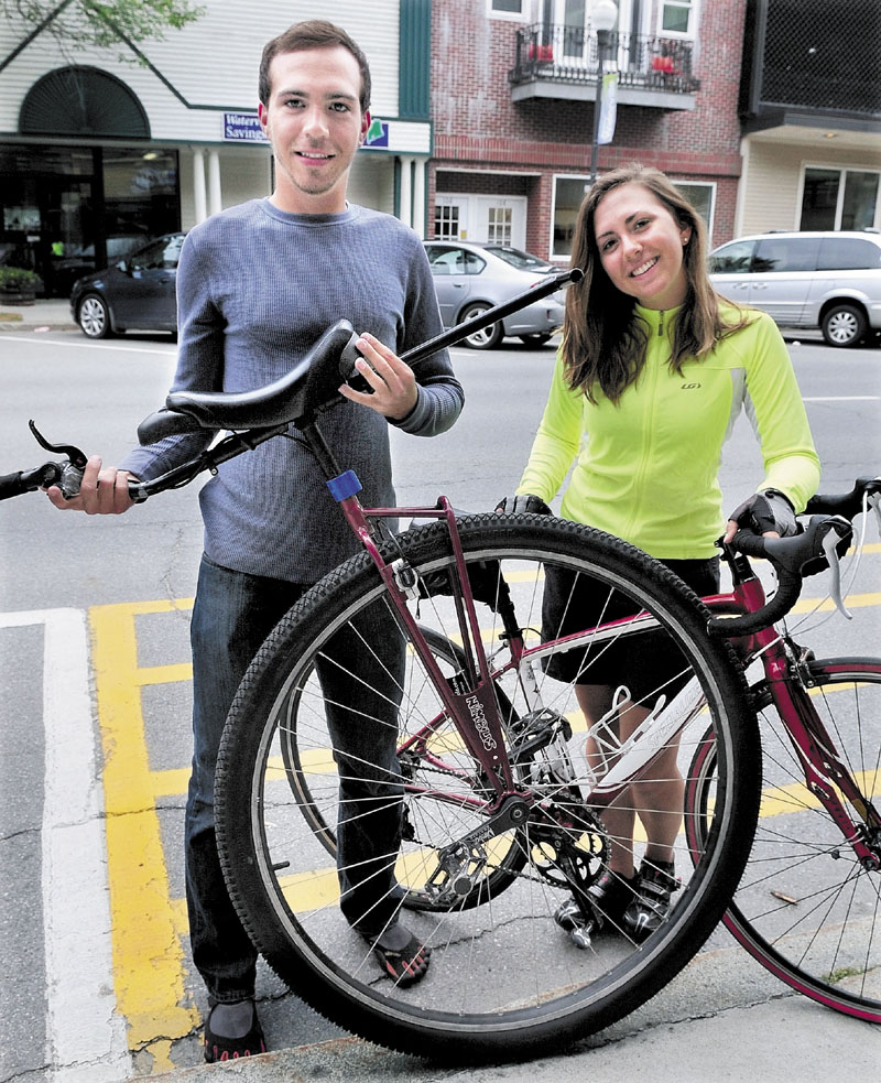 ROUND AND ROUND: Bob Mueller of Oakland and his sister Laura recently completed a 3,600-mile trip from Cape Elizabeth to Westport, Wash. and raised $4,500 for the American Red Cross' National Disaster Relief Fund. Bob rode the unicycle he is holding; Laura rode her bicycle.