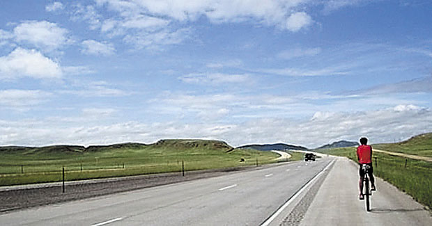 THE ROAD: Bob Mueller on Interstate 90 in Wyoming during his unicycle ride across the country on July 14. His blog, www.bobacrossamerica.com, recounts the trip, including this post by his sister.
