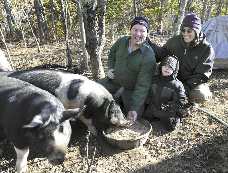 KEEP ON GIVING: From left, Glen Powers, 4-year-old son Nestor and wife Rachel have donated 450 pounds of vegetables, 50 chickens (each weighing about 5 pounds) and 45 Giant White turkeys (each weighing about 20 pounds) to the Augusta Food Pantry with what they raised at their Windsor home.