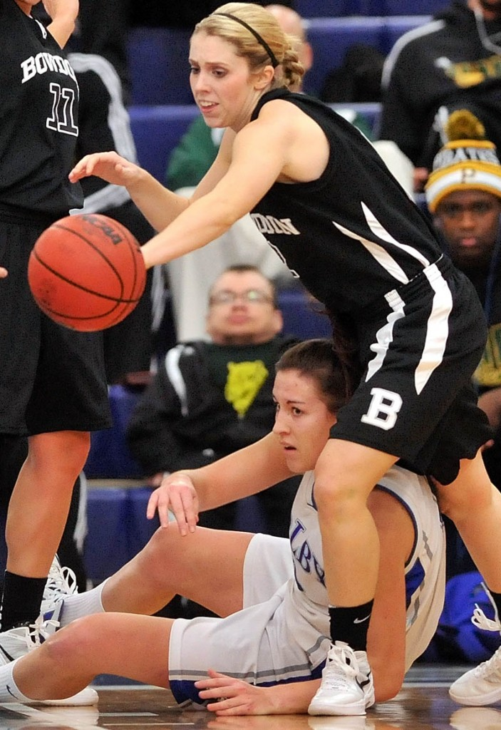 TOUGH BATTLE: Colby College's Rachael Mack, center, fights for the loose ball with Bowdoin College's Kaitlin Donahoe, right, in the first half of basketball action Saturday at Wadsworth Gymnasium at Colby College in Waterville.