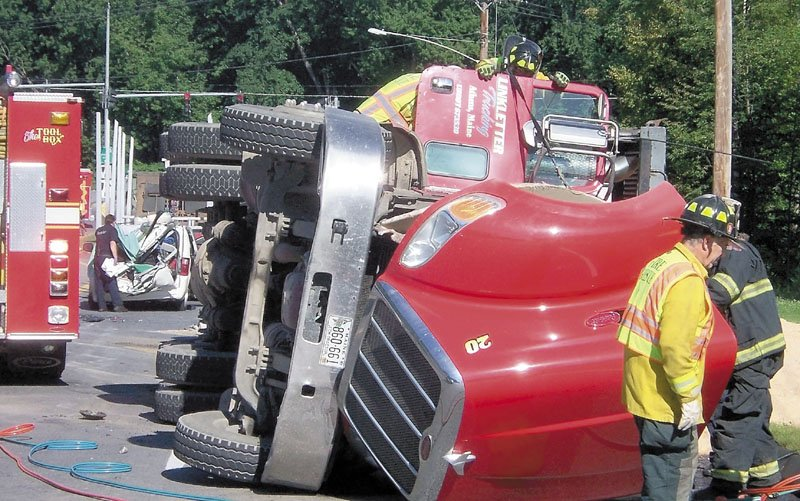 DEADLY CRASH: Emergency responders work at the scene of a fatal crash involving a tractor-trailer and a minivan Aug. 17 in Farmington. Franklin County authorities said Tuesday that the driver of the truck, Charles Willey, 53, of Dexter, will not face charges for the incident.
