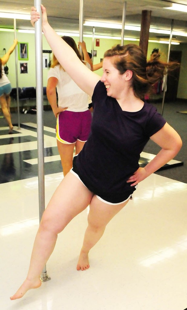 Brittany Rogers circles the pole during a class on Wednesday night at Heaven-Lee Heights Inc. at 553 Maine Ave., Farmingdale.