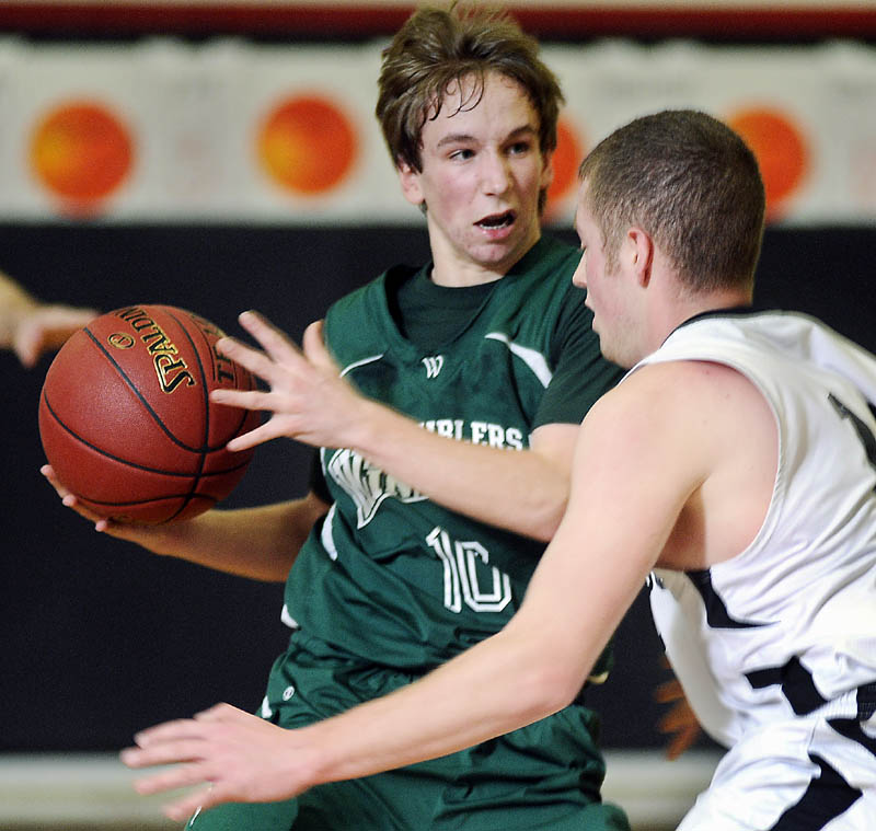 COMING THROUGH: Winthrop High School's Taylor Morang, left, attempts to dribble past Hall-Dale High School's Tyler French during a game Mondayin Farmingdale.
