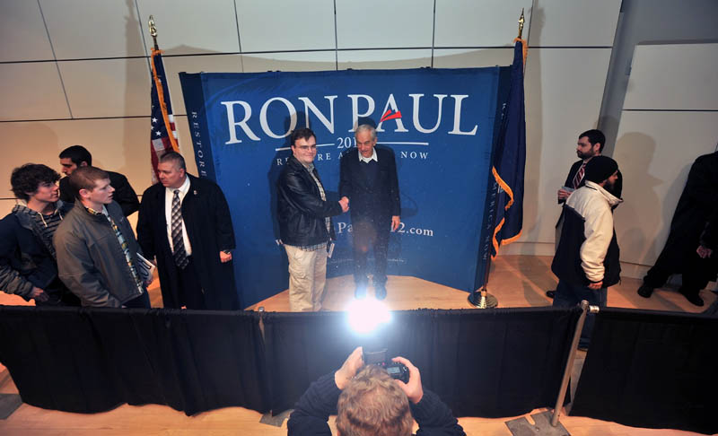 LINING UP: Ron Paul greets supporters after a speech at Colby College on Friday.