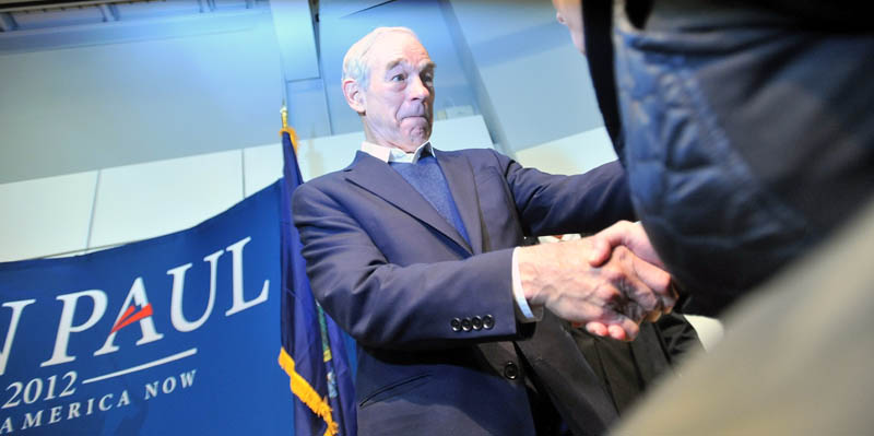 ON THE TRAIL: Ron Paul shakes hands with supporters after a campaign speech at Colby College's Ostrove Auditorium on Friday.