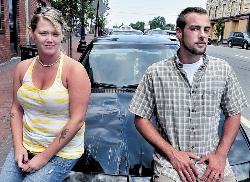NOT THIS YEAR: Christina Tirrell and Lucas Drinkwater are shown last July beside Tirrell's vehicle, which she says was hit by a truck after the 2011 West Athens Fourth of July parade. Drinkwater said he was beaten and injured in a fight after the accident. This year's parade has been cancelled.