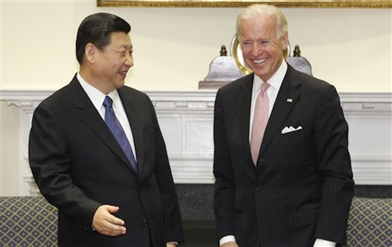 Vice President Joe Biden meets with Chinese Vice President Xi Jinping in the Roosevelt Room at the White House in Washington on Tuesday, Feb. 14, 2012. (AP Photo/Charles Dharapak)