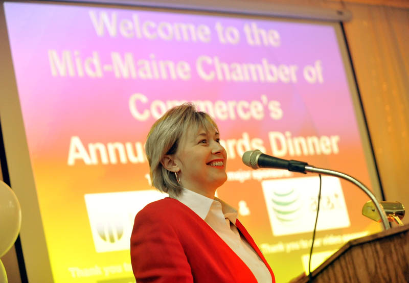 ANNUAL HONOR: Kim Lindlof, president and CEO of the Mid-Maine Chamber of Commerce, welcomes guests to the annual Mid-Maine Chamber of Commerce awards dinner at the Elks Lodge in Waterville on Wednesday night.