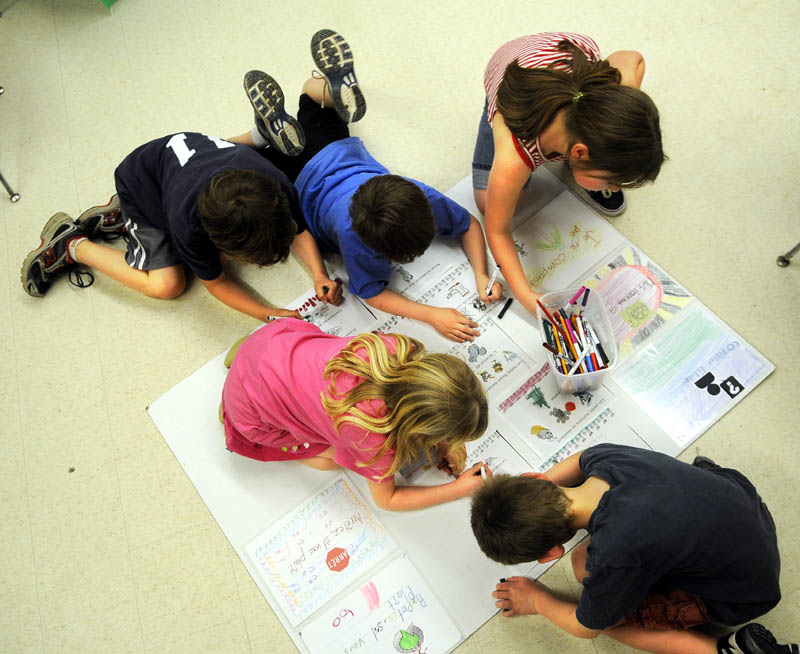 CREATIVE LEARNING: Hussey Elementary students color together Thursday during an afterschool Franco-American culture program that's funded through a grant. Franco-Americans' culture and their regional variant of the French language wasn't always appreciated, either in the streets of Augusta or the classroom.