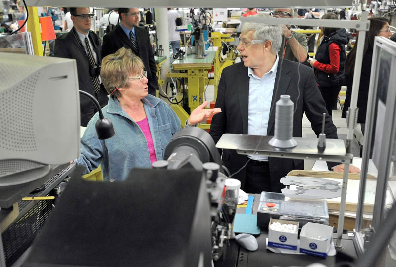Rep. Mike Michaud speaks to New Balance factory employee Rose Bailey during a tour of the New Balance shoe factory in Norridgewock today.