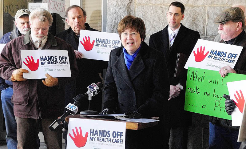 Carol Weston, State Director of Americans for Prosperity, speaks during a rally held on the granite portico at the Kennebec County Superior Courthouse,on Tuesday. The rally will be held the same day that the U.S. Supreme Court hears oral arguments over the constitutionality of President Obama's health care law.