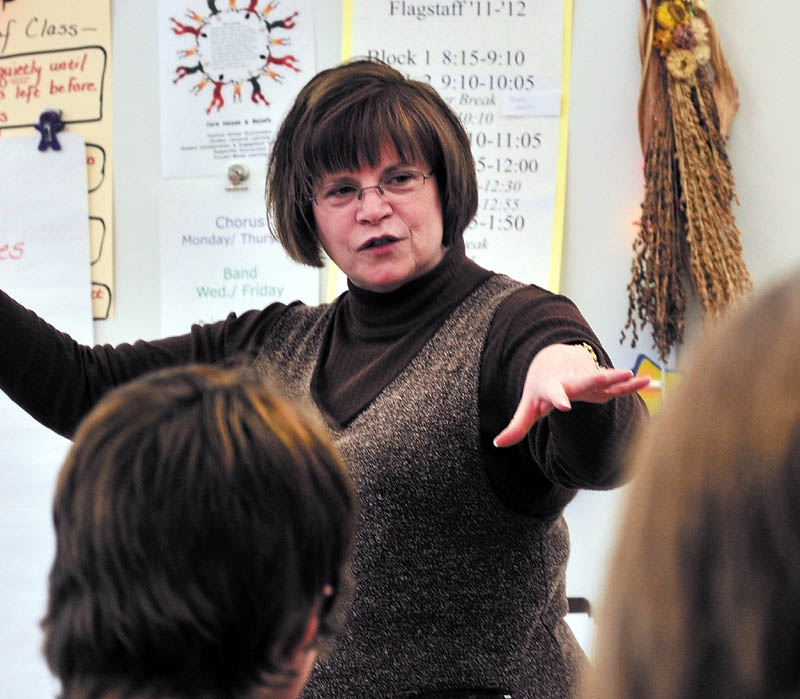 NEW WAYS: Messalonskee Middle School language arts teacher Linda Haskell instructs students in Oakland recently.