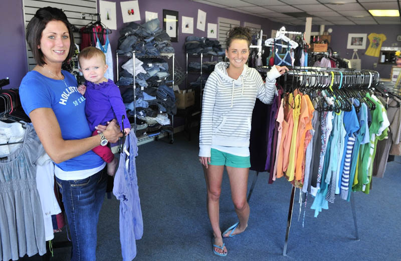 Erin Savage, holding her daughter Grace, and co-owner Hope Allain of The Swap boutique in Skowhegan are sponsoring a fashion show on Sunday to benefit the women's homeless shelter in Solon. The show is from 3 to 6 p.m. at T&B Celebration Center.