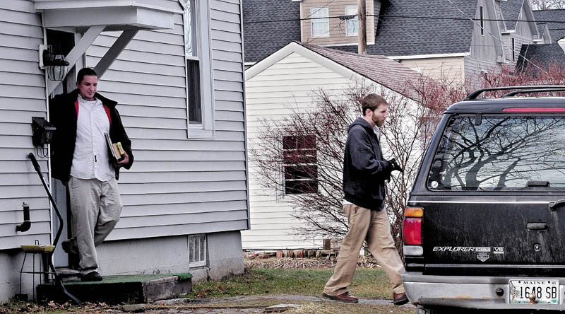 PLEA: Lance DiPietro, left, and his brother Justin DiPietro, leave 29 Violette Ave. in Waterville in December where Ayla Reynolds was reported missing. Lance DiPietro pleaded not guilty to a charge that he assaulted Justin Linnell in a city parking lot.