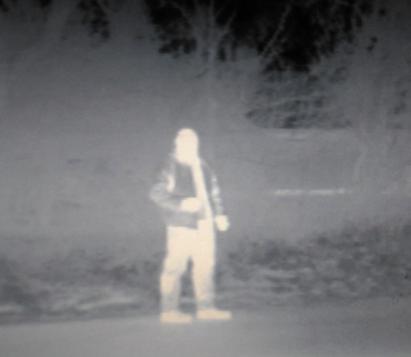 NIGHT EYES: Kennebec County Sheriff's Deputy Mike Dutil is seen through a thermal imaging camera on his cruiser.