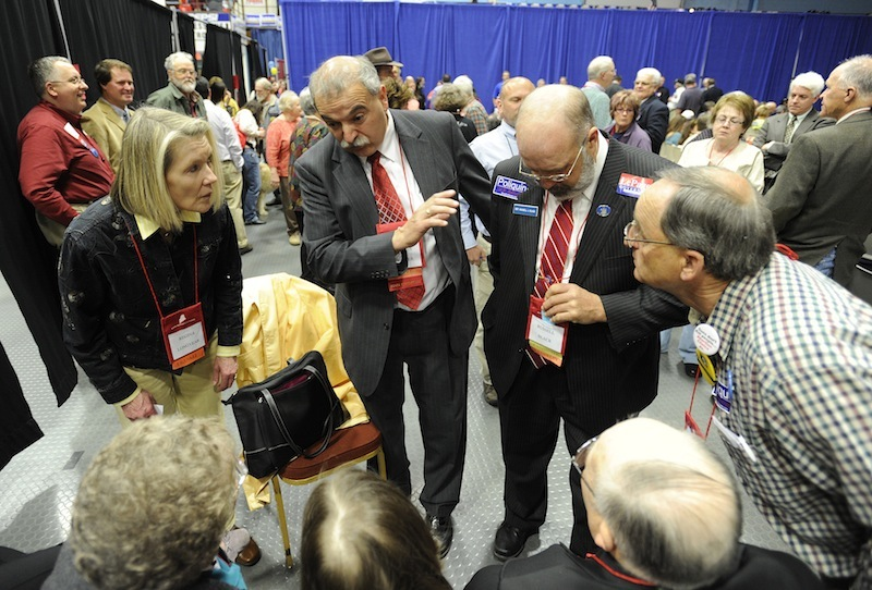 Maine Republican Party Chairman Charlie Webster, second from left, talks with delegates during the Maine Republican Party State Convention on Sunday.