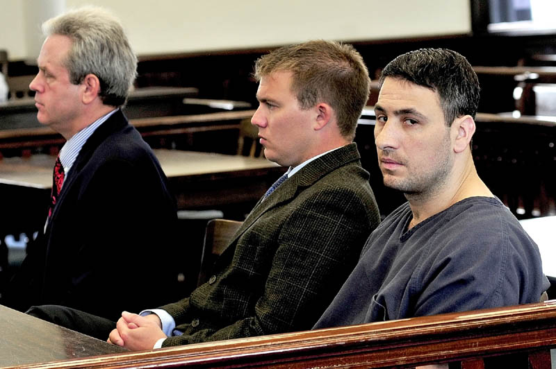 HEARING: Murder defendant Angelo Licata, right, sits with his attorneys Peter Barnett, left, and Francis Griffin during a hearing in Somerset County Superior Court in Skowhegan on Thursday.