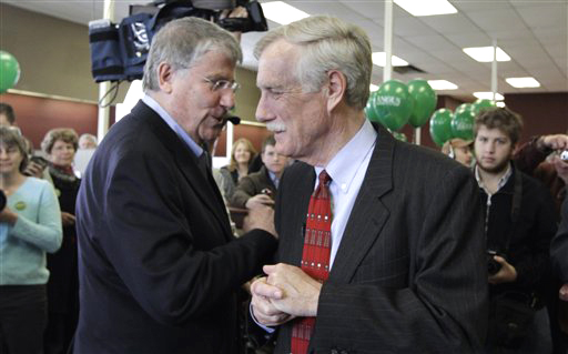 Angus King, Independent candidate for the U.S. Senate, right, speaks to former Independent gubernatorial candidate Eliot Cutler at an event in April. King has come under fire for purchasing tickets to an Obama fundraiser before Olympia Snowe withdrew from the race.