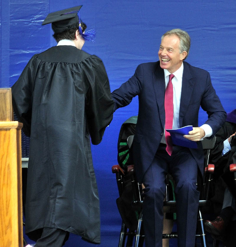 Colby College senior class speaker Samuel Deeran thanks commencement speaker and former Prime Minister of Britain Tony Blair in Waterville on Sunday.