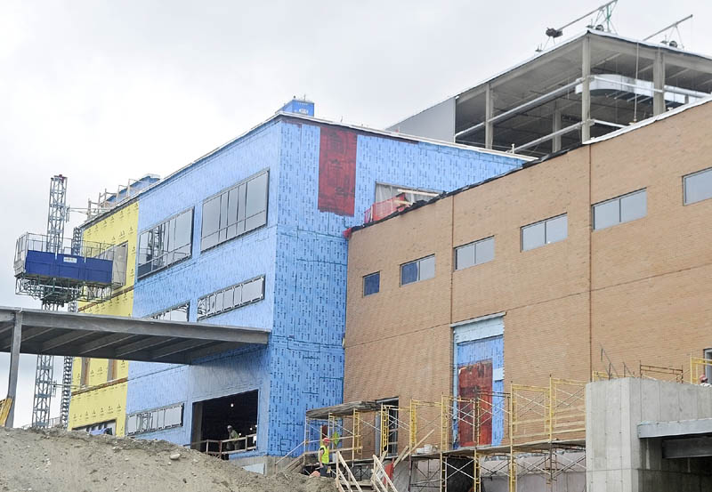 The walls of the loading dock already have the brick finish as other stages of construction are seen behind them at MaineGeneral's new regional hospital under construction in North Augusta.
