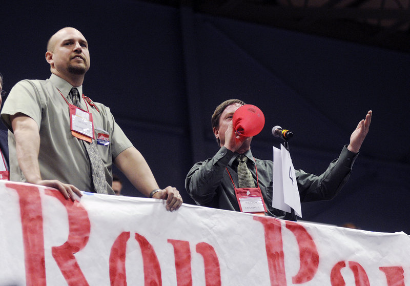 Bill Crandall of Farmington shouts out to the convention chair as he objects to the proceedings during the Maine Republican State Convention at the Augusta Civic Center on Sunday. At left is Hutch McPheters of Wilton.