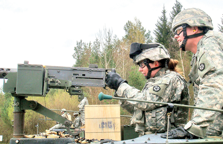 Master Sgt. Renee Baldwin fires a .50-caliber machine gun during training last summer at Joint Multinational Training Command's Grafenwoehr range in Germany. Women will soon be allowed in six additional military occupational specialties normally located within combat units.