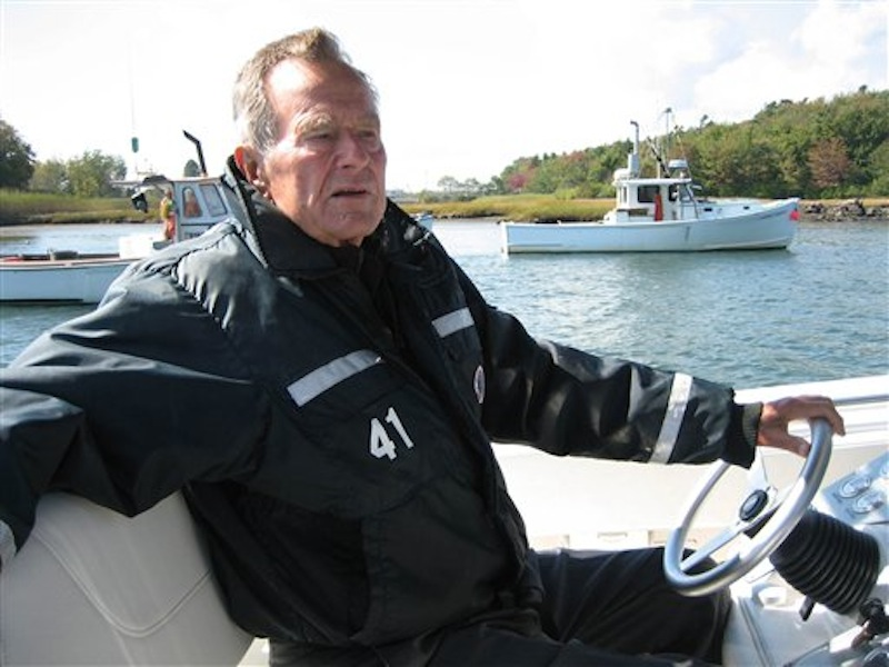 This undated image released by HBO shows former President George H.W. Bush on his boat in Kennebunkport, Maine during the filming of the documentary