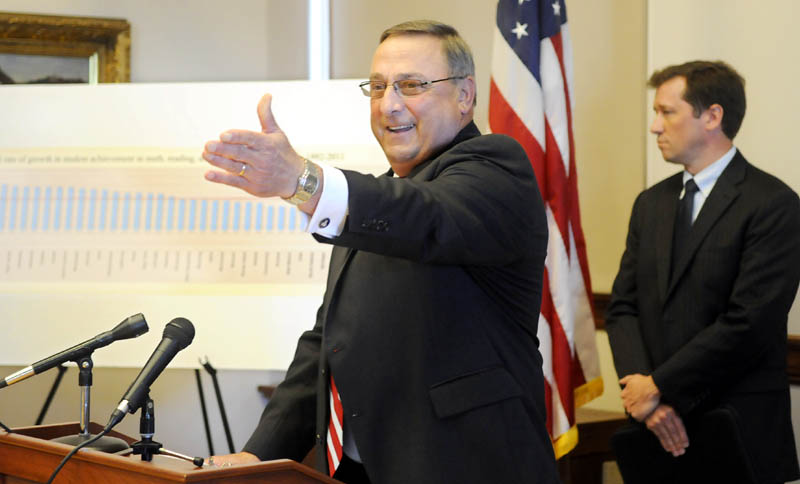 Governor Paul LePage and Commissioner of Education Stephen Bowen, right, react to a report by Harvard University's Program on Education Policy and Governance during a press conference Wednesday in Augusta.