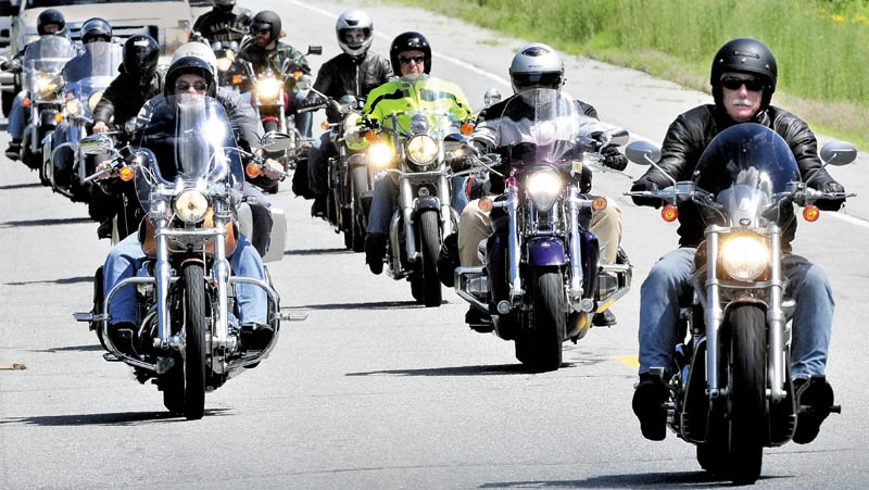 THE ROAD TO NOVEMBER: Angus King, former Maine governor and candidate for U.S. Senate, right, leads a group of motorcyclists after a campaign tour stop in Skowhegan on Wednesday.