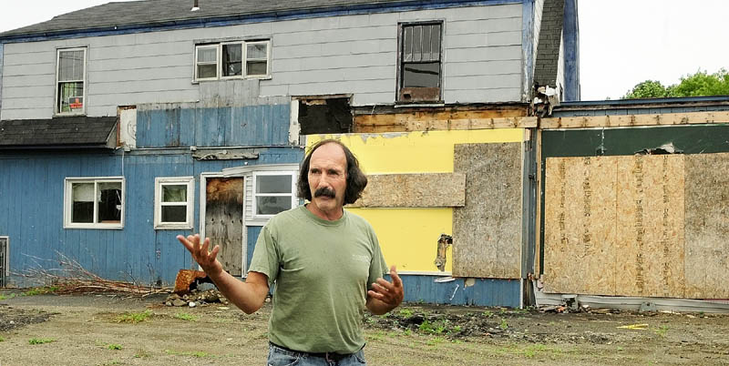 PLANS: Ray Breton talks about his plans to demolish the former Carl's Quick Stop on Wednesday afternoon in North Vassalboro.