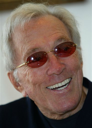 FILE - In this July 25, 2004 file photo, U.S. singer Andy Williams smiles as he speaks to reporters during his news conference at a Tokyo hotel. Emmy-winning TV host and