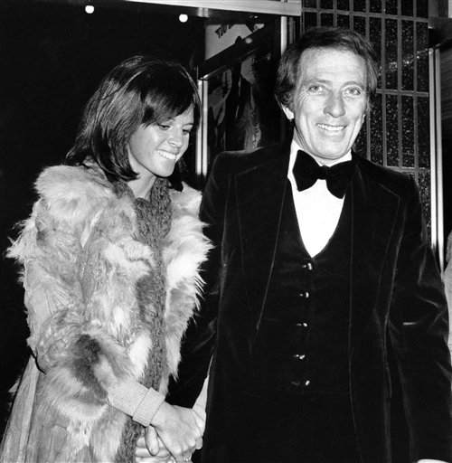 FILE - In a Dec. 19, 1974 file photo, American singer Andy Williams and his wife Claudine Longet, shown upon arrival at the Odeon, Leicester Square, London, for the Royal Charity World premiere of