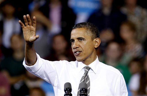 President Barack Obama speaks at a campaign event at The Memorial Athletic and Convocation Center at Kent State University Wednesday, Sept. 26, 2012, in Kent, Ohio. (AP Photo/Tony Dejak)