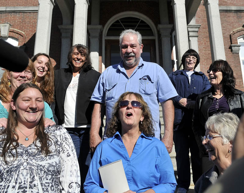Staff photo by Michael G. Seamans Christine Belangia, of Weld, celebrates with friends and family on the steps of Somerset County Superior Court after Jay Mercier was found guilty for the murder of her sister Rita St. Peterat in Skowhegan this week.