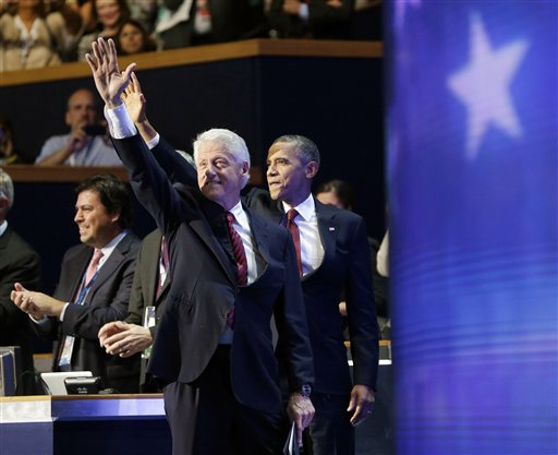 President Barack Obama, right, joins former President Bill Clinton, left, on stage at the Democratic National Convention, Wednesday, Sept. 5, 2012, in Charlotte, N.C. (AP Photo/Pablo Martinez Monsivais)