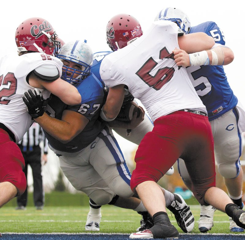 AN ALL-AROUND ATHLETE: John Gilboy (67), an offensive lineman for the Colby College football team, has a 3.7 grade-point average and is a double major. He also throws the shot on the indoor and outdoor track and field teams.