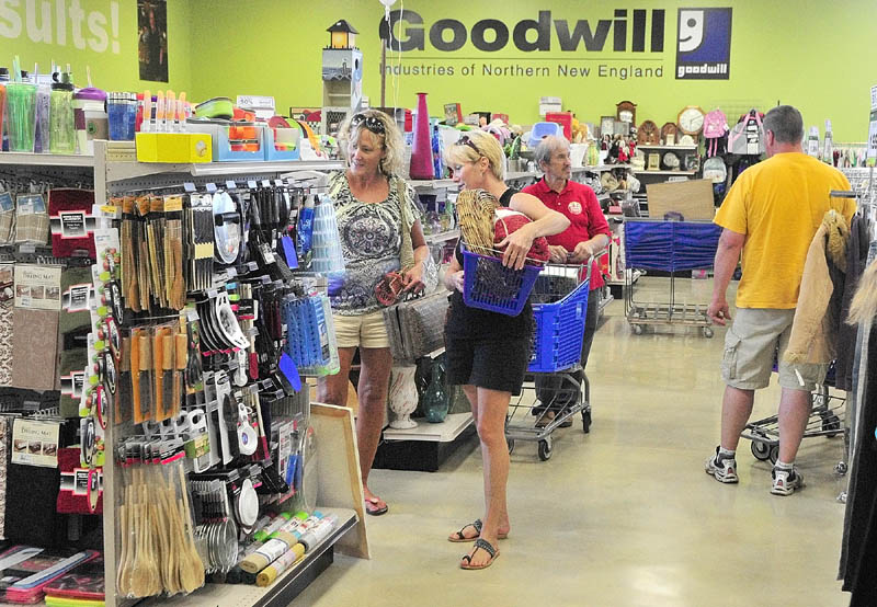 Shoppers browse in the new location of the Goodwill store that opened at 5 Senator Way on Thursday in Augusta. The new store has 10,000 square feet of retail space plus 7,000 square feet of backroom space to process donations, according to store manager Isis Truman.