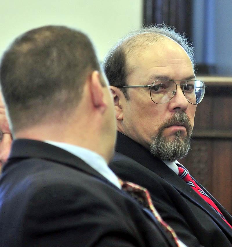 Murder defendant Jay Mercier looks around in court during his trial in Somerset County Superior Court in Skowhegan.