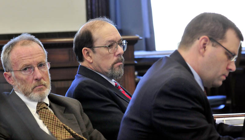 Staff photo by David Leaming DEFENSE: Murder defendant Jay Mercier sits between defense attorneys John Alsop, left, and John Mitchell during Mercier's trial in the death of Rita St. Peter being held at Somerset County Superior Court in Skowhegan this week.