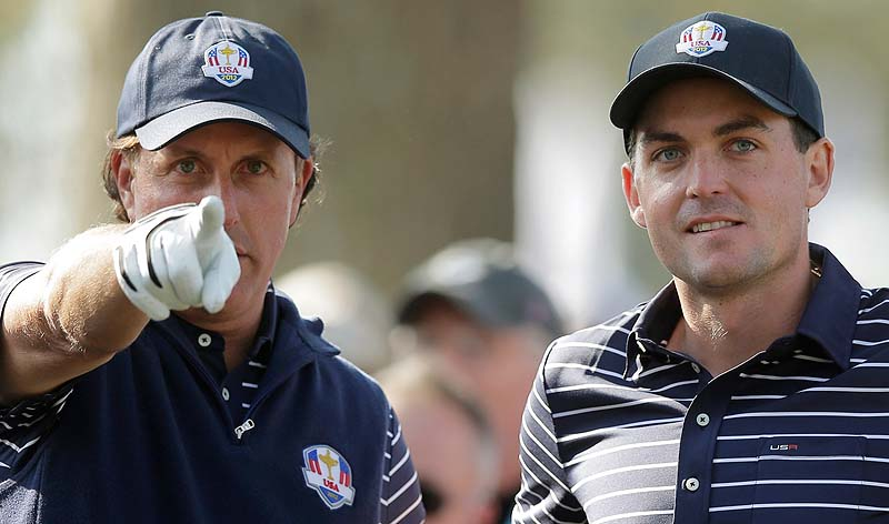 Phil Mickelson talks to Keegan Bradley on the 12th tee during a foursomes match at the Ryder Cup Saturday at the Medinah Country Club in Medinah, Ill.