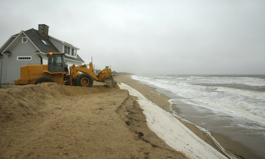 At the end of Fairhaven Avenue in Saco on Monday, October 29, 2012, a payloader builds up a dirt berm to protect the street from erosion expected to happen because of the storm surge hitting the coast from hurricane Sandy.