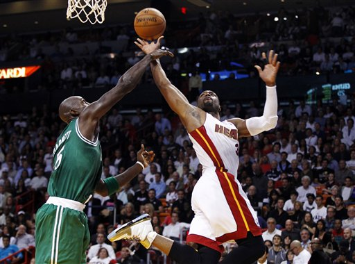 Boston Celtics' Kevin Garnett (5) tries to block a shot by Miami Heat's Dwyane Wade (3) during the first half of an NBA basketball game in Miami, Tuesday, Oct. 30, 2012. The Heat won 120-107. (AP Photo/J Pat Carter)