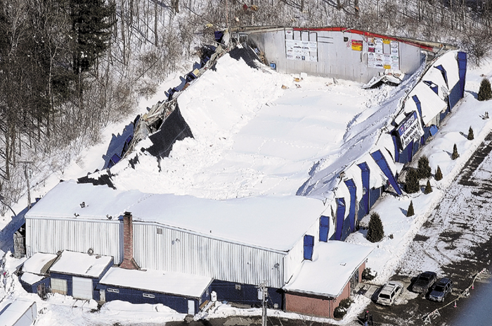 This aerial photo, taken Thursday, March 3, 2011, shows the collapsed roof of the Kennebec Ice Arena in Hallowell. The arena is suing its insurers, claiming coverages were inadequate for the damages sustained in the collapse.