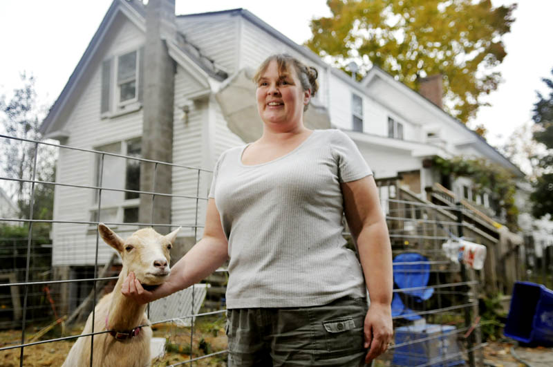 GOT GOAT: Marciana Johnson is raising goats with her family in the back yard of their Gardiner home in defiance of a city ordinance. Johnson hopes to change the ordinance to permit small farm animals within the urban compact.