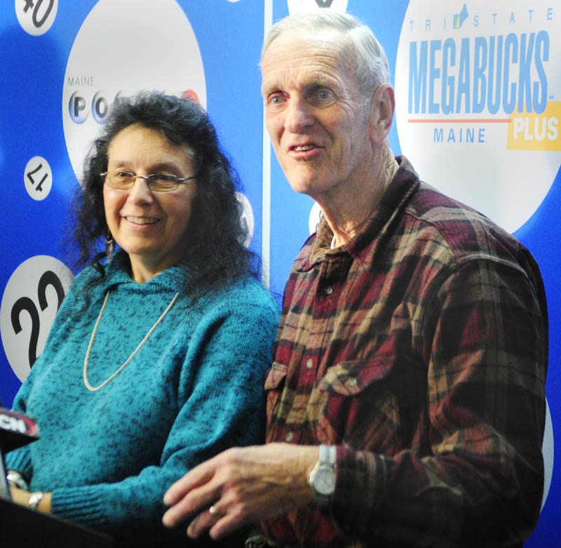 Lottery winner Linda Von Oesen, of Fairfield, left, and her husband Bob Von Oesen speak to reporters about winning the Tri-State Megabucks Plus during a news conference on Thursday morning in Hallowell.